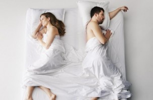 Mid-adult-couple-sleeping-in-bed-elevate-1