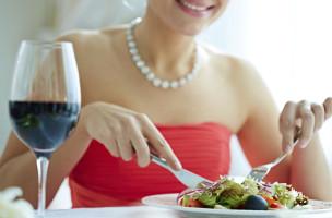 Woman eating healthy vegetarian salad