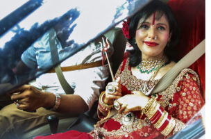 epa04883508 India's self-styled incarnation of the Hindu goddess Durga, Radhe Maa (R), leaves after questioning at the Kandiwali Police Station in Mumbai, India, 14 August 2015. According to local reports Maa attracts thousands of devotees who believe she has supernatural powers and can perform miracles. However, now she is being questioned in connection to harassment by her husband's family of a woman related to a dowry.  EPA/DIVYAKANT SOLANKI