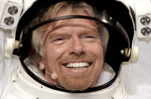 Sir Richard Branson  wears a space suit costume to promote his sweepstakes, where a winner gets a flight aboard a Virgin Galactic spaceship, the announcement was made during the Volvo display at the New York International Auto Show Thursday 24 March 2005.  (KEYSTONE/EPA/PETER FOLEY)