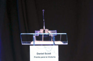 The name of Daniel Scioli, the ruling party presidential candidate, is seen on a lectern during the debate between presidential hopefuls in Buenos Aires, Argentina, Sunday, Oct. 4, 2015. Five presidential candidates in Argentina shared their ideas with the nation in a televised debate but poll leader, ruling party candidate Daniel Scioli, decided not to participate in Sunday's debate. (AP Photo/Agustin Marcarian)