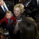 epa05245685 Democratic presidential candidate Secretary Hillary Clinton holds a baby after speaking during a campaign event at Medgar Evans College in Brooklyn, New York, USA, on 05 April 2016. New York will hold its primary election on 19 April 2016.  EPA/JUSTIN LANE