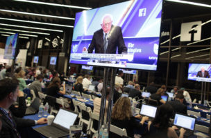 Democratic U.S. presidential candidate Senator Bernie Sanders is shown on video screens as journalists work during the Univision News and Washington Post Democratic U.S. presidential candidates debate in Kendall, Florida March 9, 2016.  REUTERS/Javier Galeano - RTSA3VN