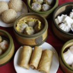 This Tuesday, Dec. 21, 2010 photo shows servings of Dim Sum including egg rolls, dumplings, sesame balls and har gow at the Four Seas Restaurant in Chinatown in San Francisco.  Dumplings symbolize prosperity and are traditionally eaten late on the eve of the Chinese New Year.    (AP Photo/Eric Risberg)