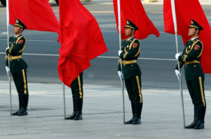 A red flag covers a soldier from Chinese honour guards during a welcoming ceremony for Swiss President Johann Schneider-Ammann at the Great Hall of the People in Beijing, China, April 8, 2016. REUTERS/Kim Kyung-Hoon   - RTSE57T