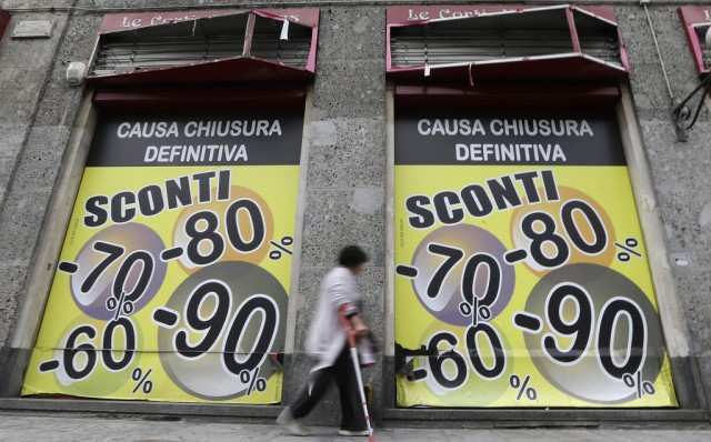 "A woman walks in front of a closed shop with a banner reading, ""due to final closure discounts up to 60, 70, 80, 90 per cent"", in Milan, Italy, Wednesday, Oct. 10, 2012. The most troubled European nations remain gripped by dismal economies. Unemployment in the eurozone as a whole is 11.4 percent. Greece, Spain, Italy, Cyprus, Malta and Portugal are in recession. (AP Photo/Luca Bruno)"