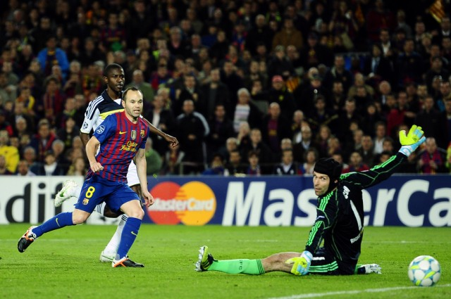 FC Barcelona's Andres Iniesta, left, scores past Chelsea's goalkeeper Petr Cech from Czech Republic during a semifinal second leg Champions League soccer match at the Camp Nou stadium in Barcelona, Spain, Tuesday, April 24, 2012. (AP Photo/Manu Fernandez)