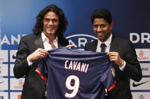 Paris Saint Germain's club president Nasser al-Khelaifi (R) and Uruguay's soccer player Edinson Cavani pose after a news conference at the Parc des Princes stadium in Paris July 16, 2013. Paris St Germain signed last season's Serie A top scorer Edinson Cavani from Napoli on a five-year contract, the French Ligue 1 champions said on Tuesday.    REUTERS/Charles Platiau  (FRANCE - Tags: SPORT SOCCER) - RTX11OK2