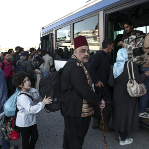 "Migrants and refugees get on a bus which will transfer them at a metro station after their arrival from the Greek island of Lesbos at the Athens' port of Piraeus, Sunday, Oct. 4, 2015. The U.N. refugee agency is reporting a ""noticeable drop"" this week in arrivals of refugees by sea into Greece _ as the total figure for the year nears the 400,000 mark. Overall, the UNHCR estimates 396,500 people have entered Greece via the Mediterranean this year with seventy percent of them are from war-torn Syria. (AP Photo/Yorgos Karahalis)"