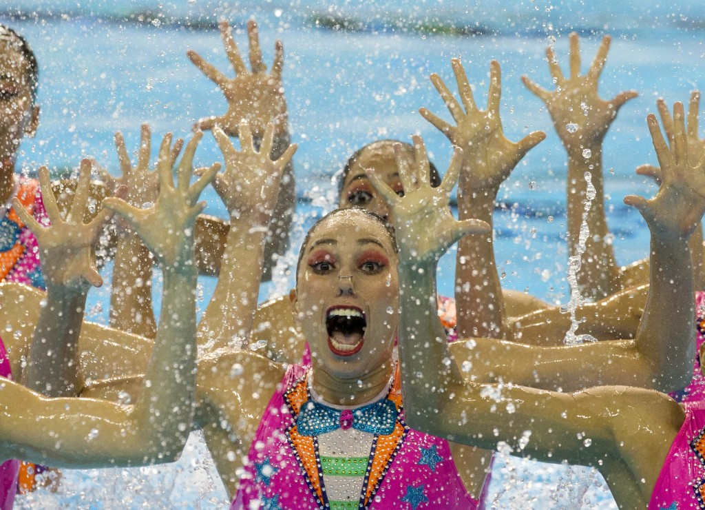Members of Mexico's synchronised swimming team perform a clown inspired number for their free routine at the Pan Am Games in Toronto, Saturday, July 11, 2015. Mexico won silver in the event.(AP Photo/Rebecca Blackwell)