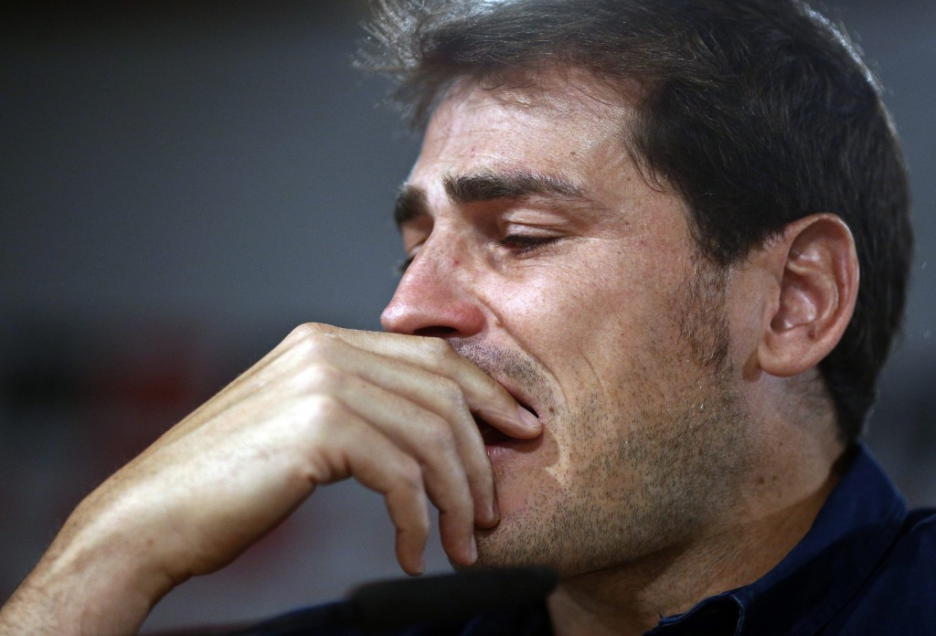 Real Madrid's goalkeeper Iker Casillas reacts during press conference at the Santiago Bernabeu stadium in Madrid, Spain, Sunday, July 12, 2015. Casillas is leaving Real Madrid to join Portuguese club FC Porto after 16 seasons in which he helped the Spanish powerhouse win a slew of titles that included three Champions League crowns and five Spanish league trophies Casillas, 34, joined the club's youth academy at age 9 before debuting for its first team in 1999. (AP Photo/Oscar del Pozo)