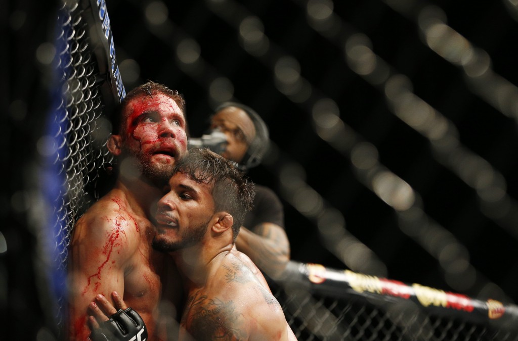 Jeremy Stephens, left, fights Dennis Bermudez during their mixed martial arts bout at UFC 189 on Saturday, July 11, 2015, in Las Vegas. (AP Photo/John Locher)