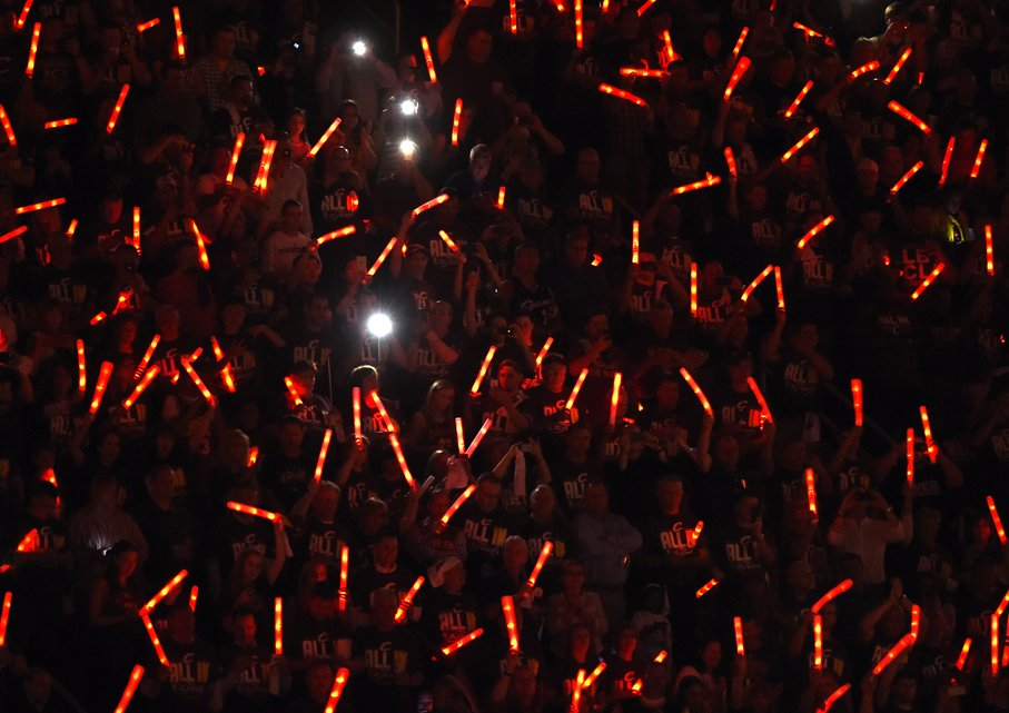 Fans cheer before the start of Game 3 between Cleveland Cavaliers and Golden State Warriors during the 2015 NBA Finals on June 9, 2015 at Quicken Loans Arena in Cleveland, Ohio. AFP PHOTO  / TIMOTHY A. CLARY