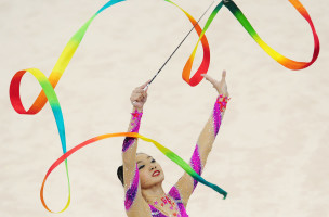 Tong Kah Mun of Singapore performs her ribbon routine during the gymnastics rhythmic individual all round final at the 28th Southeast Asian Games (SEA Games) in Singapore on June 14, 2015.    AFP PHOTO / MOHD FYROL