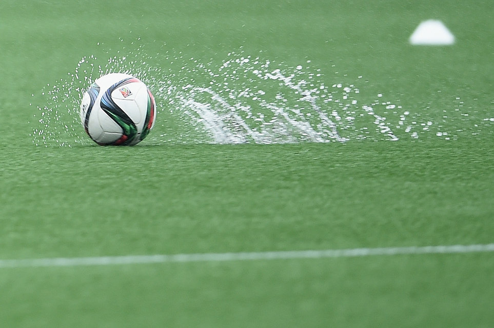 MONTREAL, QC - JUNE 28:  Water is thrown up as heavy rain falls during a training session at Stade De Montreal on June 28, 2015 in Montreal, Canada.  (Photo by Dennis Grombkowski/Bongarts/Getty Images)