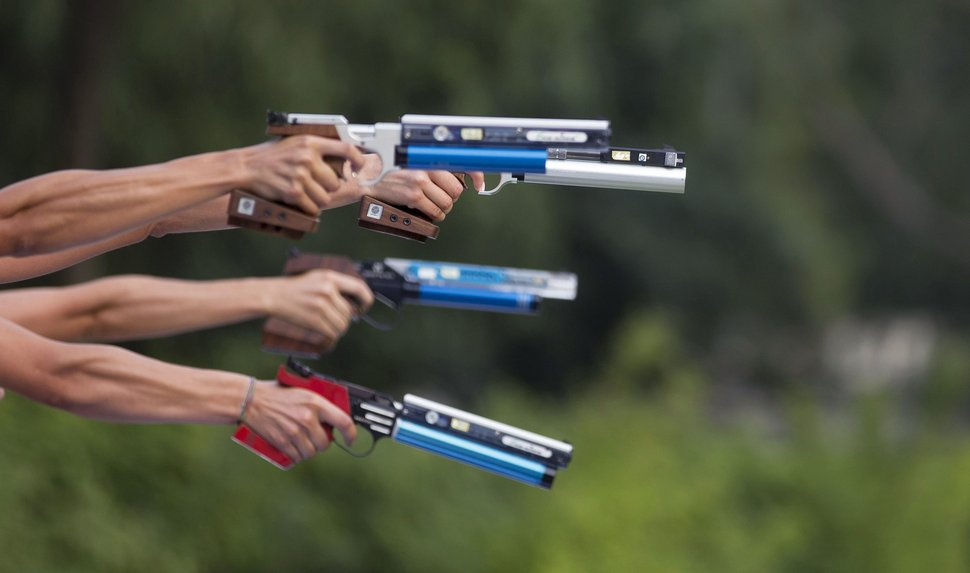 Women aim their guns, during the women's combined competition of the Modern Pentathlon World Championships in Berlin, Germany, Saturday, July 4, 2015. (AP Photo/Axel Schmidt)