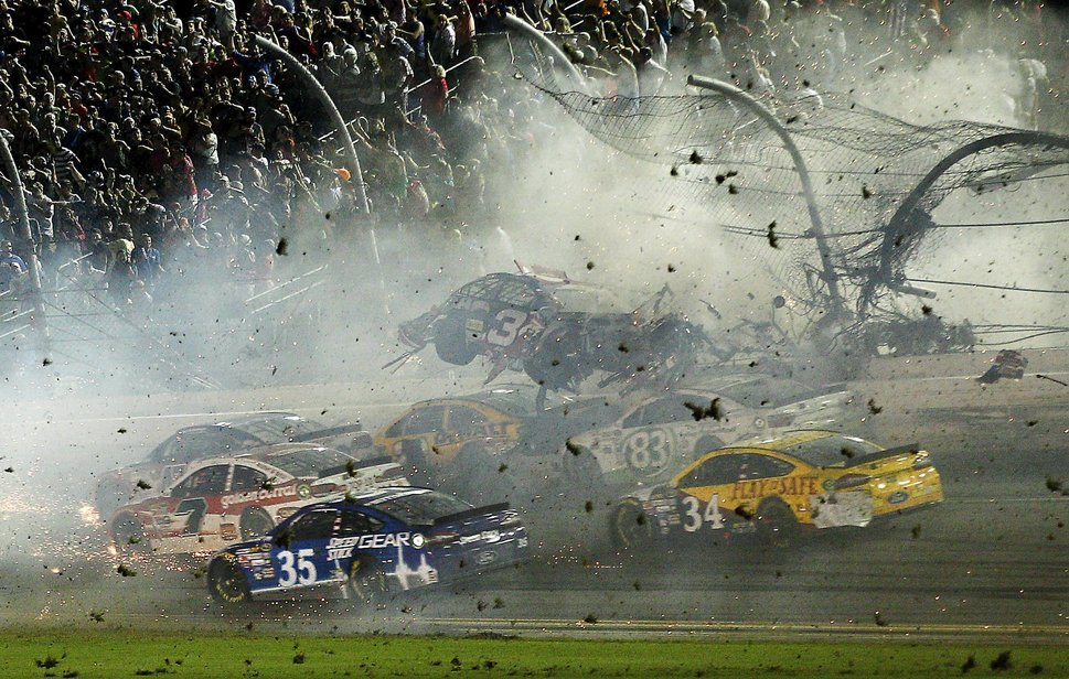 Jul 6, 2015; Daytona Beach, FL, USA; NASCAR Sprint Cup Series driver Austin Dillon's car (3) crashes against the catch fence during the finish of the Coke Zero 400 at Daytona International Speedway. Mandatory Credit: Reinhold Matay-USA TODAY Sports      TPX IMAGES OF THE DAY