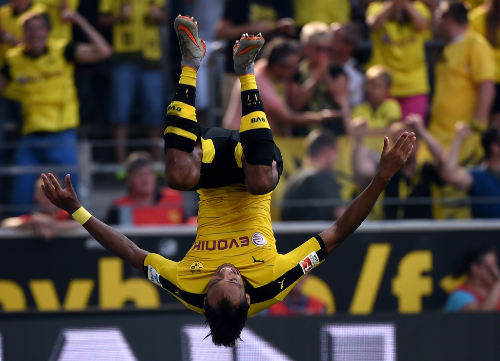 Dortmund's Gabonese striker Pierre-Emerick Aubameyang makes a jump after scoring during the German first division Bundesliga football match Borussia Dortmund vs Hertha BSC in Dortmund, Germany, on August 30, 2015.  AFP PHOTO / PATRIK STOLLARZ RESTRICTIONS: DURING MATCH TIME: DFL RULES TO LIMIT THE ONLINE USAGE TO 15 PICTURES PER MATCH AND FORBID IMAGE SEQUENCES TO SIMULATE VIDEO.  == RESTRICTED TO EDITORIAL USE == FOR FURTHER QUERIES PLEASE CONTACT DFL DIRECTLY AT + 49 69 650050.