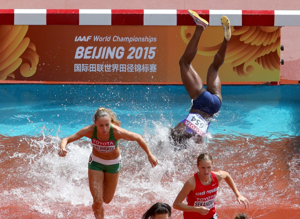 BEIJING, CHINA - AUGUST 24:  Rolanda Bell of Panama falls in the Women's 3000 metres steeplechase heats during day three of the 15th IAAF World Athletics Championships Beijing 2015 at Beijing National Stadium on August 24, 2015 in Beijing, China.  (Photo by Alexander Hassenstein/Getty Images for IAAF)