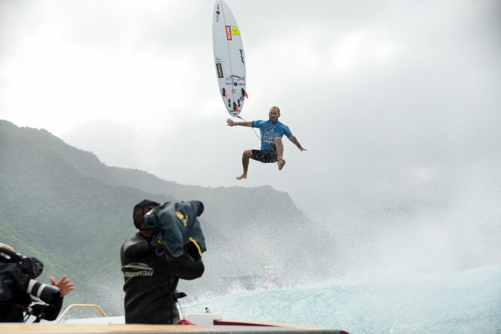 epa04899078 A handout picture made available by the World Surf League (WSL) shows US surfer CJ Hobgood flying through the air after ejecting out of a wave as the camera crew keep their camera's rolling at the Billabong Pro Tahiti at Teahupo'o on Tahiti Island, French Polynesia, 25 August 2015.  EPA/KELLY CESTARI/WSL  HANDOUT EDITORIAL USE ONLY/NO SALES