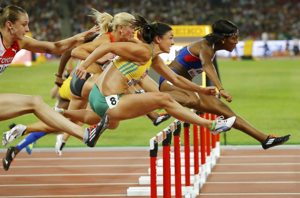 Tiffany Porter of Great Britain (R) clears a hurdle ahead of Michelle Jenneke of Australia in the women's 100 metres hurdles semi-final during the 15th IAAF World Championships at the National Stadium in Beijing, China August 28, 2015. REUTERS/Damir Sagolj