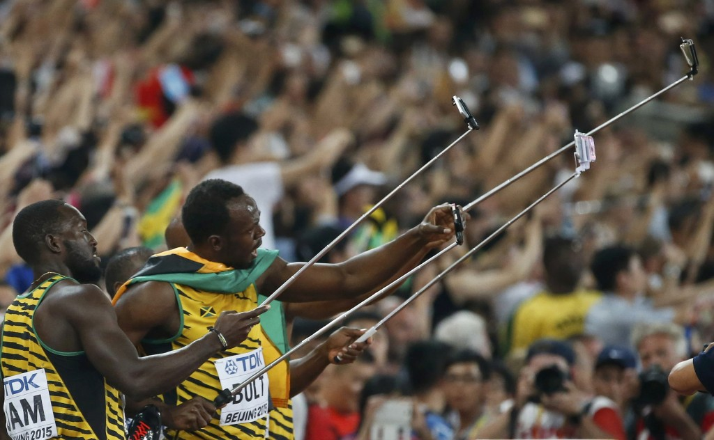 Nickel Ashmeade and Usain Bolt of Jamaica make selfies after winning the men's 4x100m relay during the 15th IAAF World Championships at the National Stadium in Beijing, China August 29, 2015.     REUTERS/Lucy Nicholson  TPX IMAGES OF THE DAY