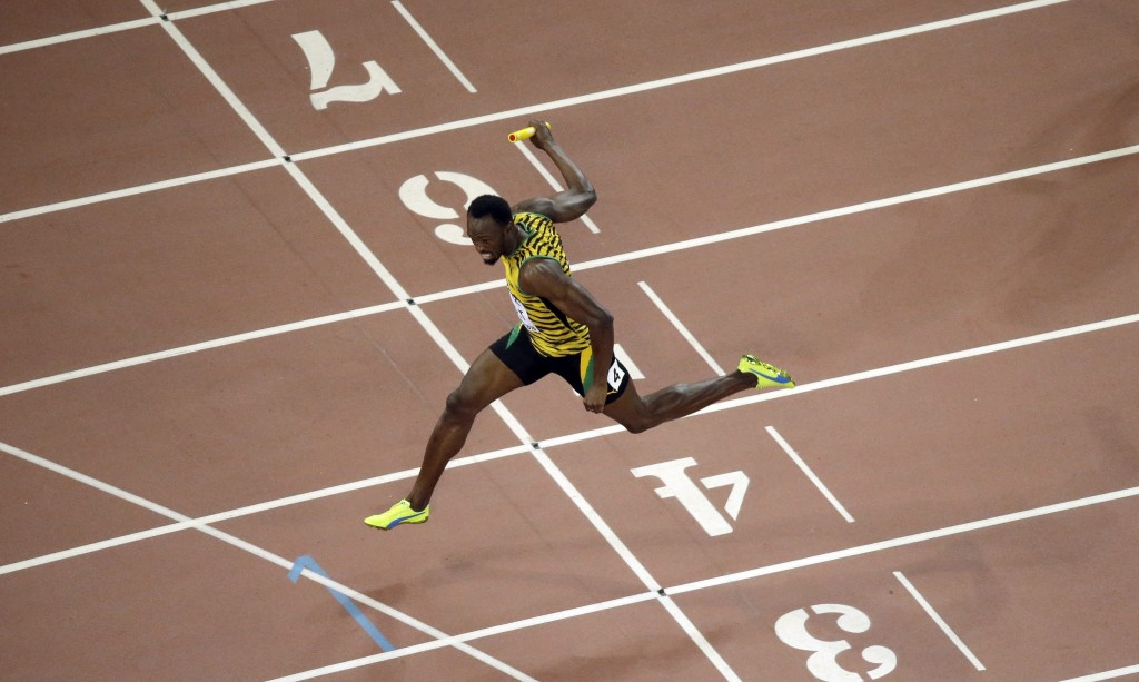 Jamaica's Usain Bolt crosses the finish line as Jamaica wins the men's 4x100m relay final at the World Athletics Championships at the Bird's Nest stadium in Beijing, Saturday, Aug. 29, 2015. (AP Photo/Wong Maye-E)