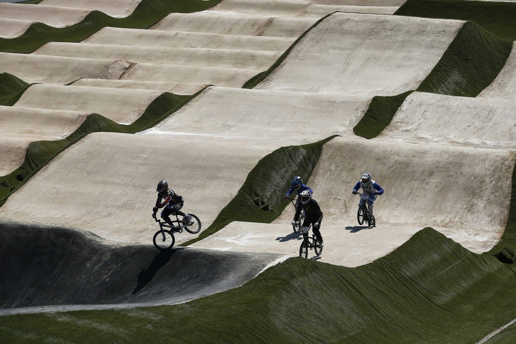 epa04905762 Athletes test the remodeled BMX race track, one of the main venues finished for the Olympic Games Rio 2016, presented by Rio de Janeiro Mayor, Eduardo Paes, Rio de Janeiro, Brazil, on 30 August 2015. The track is at the Deodoro sport complex, the second most important in the Brazilian city, which is the venue of eleven Olympic sports.  EPA/Marcelo Sayão