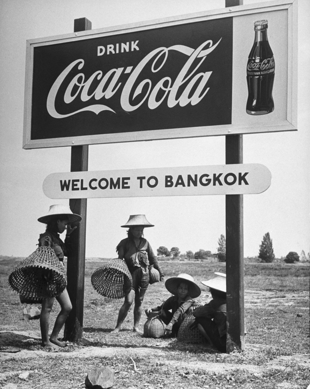 Billboard advertising Coca Cola at the outskirts of Bangkok with welcoming sign beneath saying Welcome to Bangkok. (Photo by Dmitri Kessel/The LIFE Picture Collection/Getty Images)