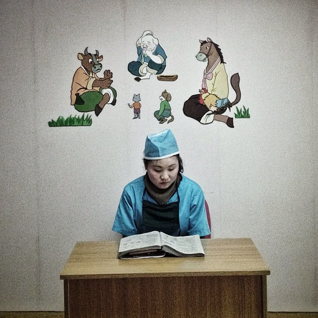 A North Korean nurse studies in a hallway at a pediatric hospital in Pyongyang..(AP Photo/David Guttenfelder)