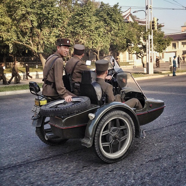 North Korean soldiers. Two on the bike, one in the sidecar. (AP Photo/David Guttenfelder)