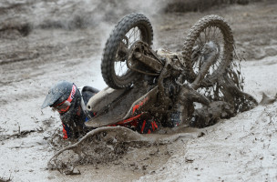 A rider crashes in the mud during the Gotland Grand National enduro race at the Tofta field of fire outside Visby on the island of Gotland, Sweden, on October 24, 2015. Gotland Grand National is the largest enduro race in the world, with 2500 competitors taking part in different classes throughout the weekend.  AFP PHOTO / TT NEWS AGENCY / MAJA SUSLIN +++ SWEDEN OUT