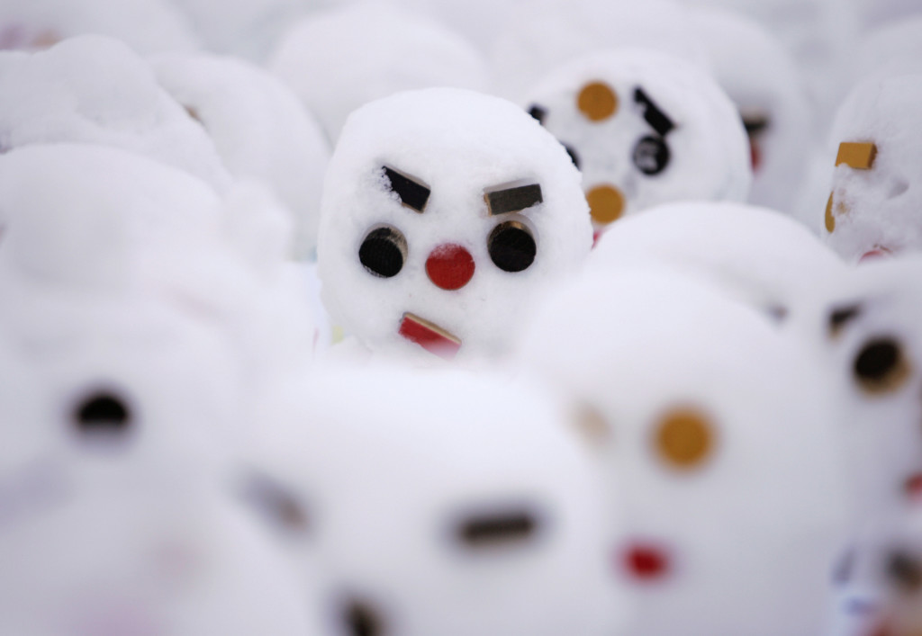 Snowmen are lined up during the Sapporo Snow Festival in Sapporo, northern Japan, February 5, 2008. REUTERS/Yuriko Nakao (JAPAN) - RTR1WPA5