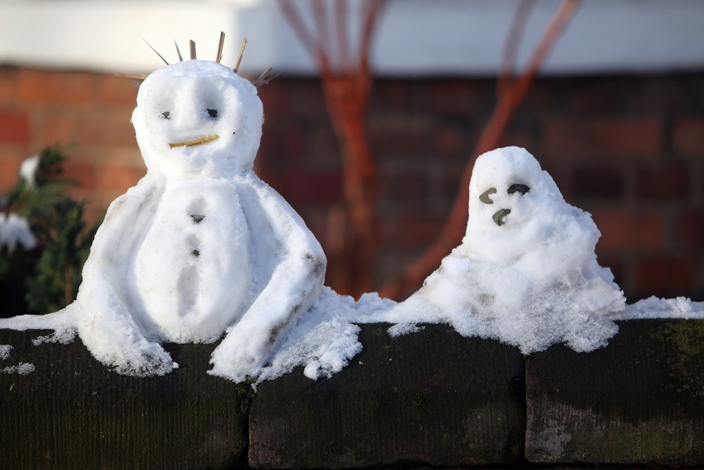 KNUTSFORD, UNITED KINGDOM - JANUARY 06: Mini snowmen sit on a wall outside a home on January 6, 2010 in Knutsford, United Kingdom. Extreme weather warnings have been issued across England as heavy snowfall has caused further disruption on roads and led to the closure of hundreds of schools and airports. According to the Met Office the latest Arctic cold snap forecast has made this Britains coldest winter for 30 years and residents of counties including Hampshire, Oxfordshire and Wiltshire have been advised to take action to avoid the worst of the snowfall. (Photo by Christopher Furlong/Getty Images)