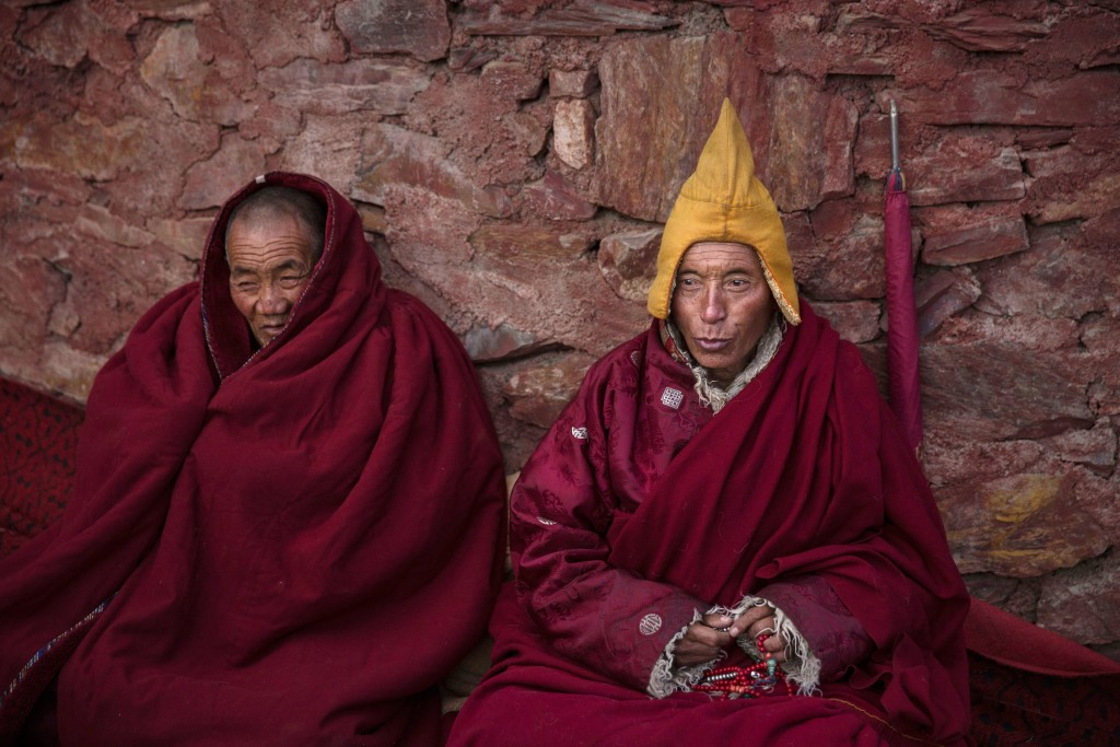 SERTAR, CHINA - OCTOBER 30: Tibetan Buddhist monks pray during a chanting session as part of the annual Bliss Dharma Assembly at the Larung Wuming Buddhist Institute on October 30, 2015 in Sertar county, in the remote Garze Tibetan Autonomous Prefecture, Sichuan province, China. The last of four annual assemblies, the week long annual gathering takes place in the ninth month of the Tibetan calendar and marks Buddha's descent from the heavens. Located high in the mountains of Sichuan, the Larung Wuming Buddhist Institute was founded in 1980 by an influential lama of the Nyingma sect and is widely regarded as the world's largest and most influential centres for Tibetan Buddhist studies. The school is home to thousands of monks and nuns and is popular for followers from all over the Tibetan areas and other parts of China. (Photo by Kevin Frayer/Getty Images)