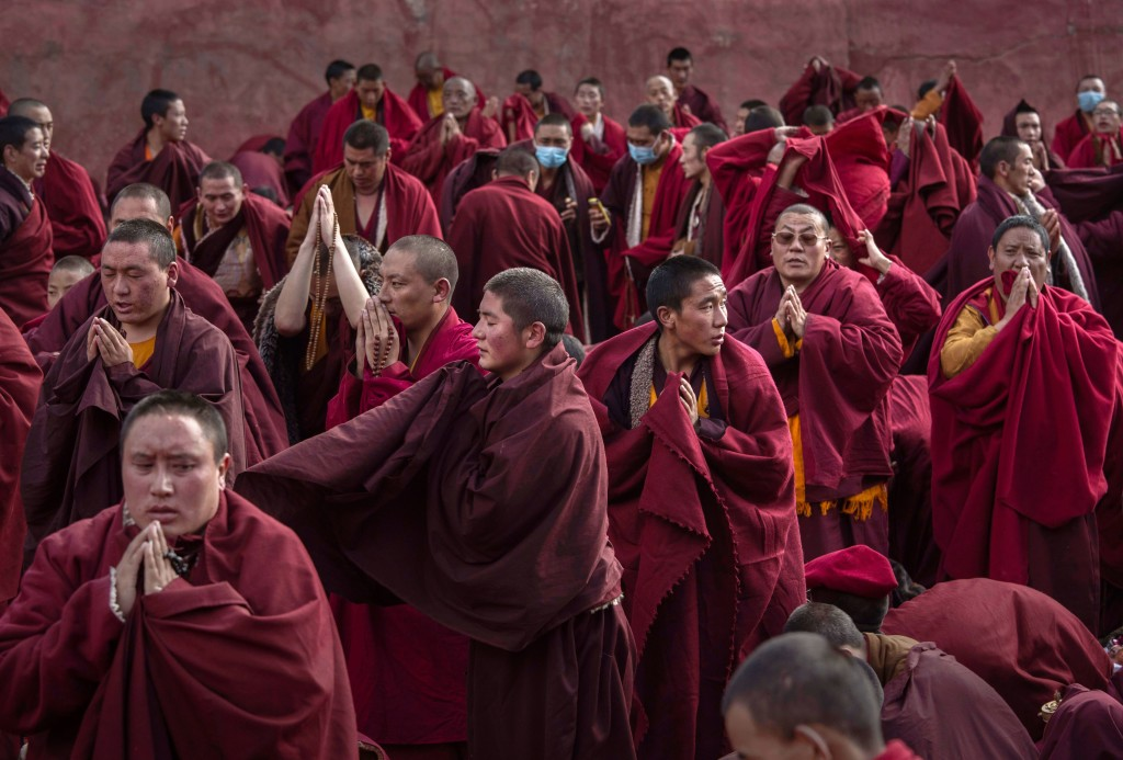SERTAR, CHINA - OCTOBER 30: Tibetan Buddhist monks pray during a morning chanting session as part of the annual Bliss Dharma Assembly at the Larung Wuming Buddhist Institute on October 30, 2015 in Sertar county, in the remote Garze Tibetan Autonomous Prefecture, Sichuan province, China. The last of four annual assemblies, the week long annual gathering takes place in the ninth month of the Tibetan calendar and marks Buddha's descent from the heavens. Located high in the mountains of Sichuan, the Larung Wuming Buddhist Institute was founded in 1980 by an influential lama of the Nyingma sect and is widely regarded as the world's largest and most influential centres for Tibetan Buddhist studies. The school is home to thousands of monks and nuns and is popular for followers from all over the Tibetan areas and other parts of China. (Photo by Kevin Frayer/Getty Images)