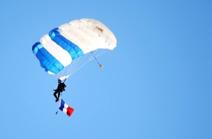 Nov 14, 2015; Colorado Springs, CO, USA; An Air Force parachuter flies onto the field before the game with a  French flag in honor of the victims of the November 13th terror attacks in Paris before the game between the Air Force Falcons and the Utah State Aggies at Falcon Stadium. Mandatory Credit: Chris Humphreys-USA TODAY Sports