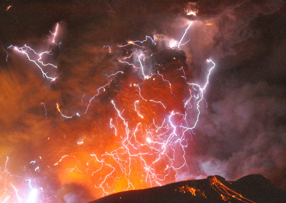Volcanic lightning or a dirty thunderstorm is seen above Shinmoedake peak as it erupts, between Miyazaki and Kagoshima prefectures, in this photo taken from Kirishima city and released by Minami-Nippon Shimbun January 28, 2011. Ash and rocks fell across a wide swathe of southern Japan straddling the prefectures of Miyazaki and Kagoshima on Thursday, as one of Mount Kirishima's many calderas erupted, prompting authorities to raise alert levels and call on for an evacuation of all residents within a 2 km (1.2 miles) radius of the volcano. REUTERS/Minami-Nippon Shimbun/Handout (JAPAN - Tags: DISASTER) FOR EDITORIAL USE ONLY. NOT FOR SALE FOR MARKETING OR ADVERTISING CAMPAIGNS. THIS IMAGE HAS BEEN SUPPLIED BY A THIRD PARTY. IT IS DISTRIBUTED, EXACTLY AS RECEIVED BY REUTERS, AS A SERVICE TO CLIENTS. JAPAN OUT. NO COMMERCIAL OR EDITORIAL SALES IN JAPAN - RTXX6PE
