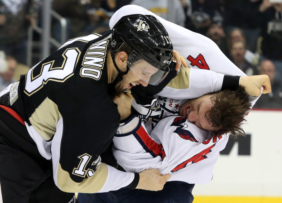 Dec 14, 2015; Pittsburgh, PA, USA; Washington Capitals defenseman Taylor Chorney (4) and Pittsburgh Penguins center Nick Bonino (13) fight during the second period at the CONSOL Energy Center. Mandatory Credit: Charles LeClaire-USA TODAY Sports - RTX1YP51
