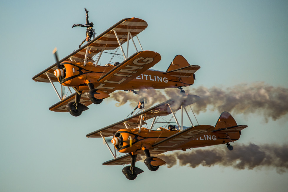 AL AIN, UNITED ARAB EMIRATES - DECEMBER 17: Current leaders, The Breitling wingwalkers during day one of the Al Ain Air Championship 2015 on December 17, 2015 in Al Ain, United Arab Emirates. (Photo by Darren Arthur/Getty Images)