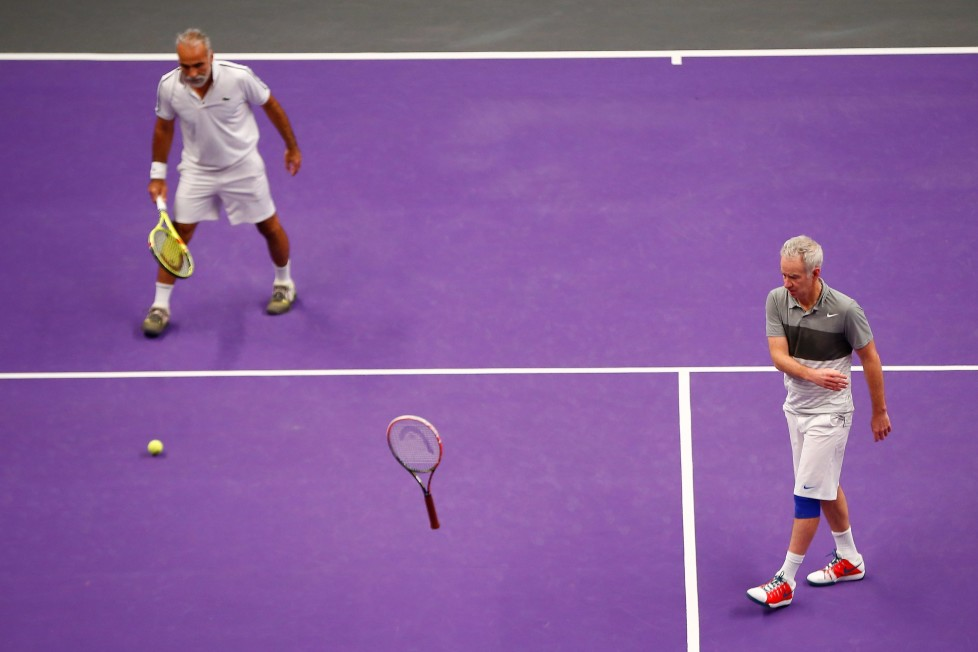 LONDON, ENGLAND - DECEMBER 05: John McEnroe of the USA (R) throws his racket partnering Mansour Bahrami of France (L) in their doubles match against Pat Cash of the USA and Mikael Pernfors of Sweden during day four of the Statoil Masters Tennis at the Royal Albert Hall on December 5, 2015 in London, England. (Photo by Jordan Mansfield/Getty Images)