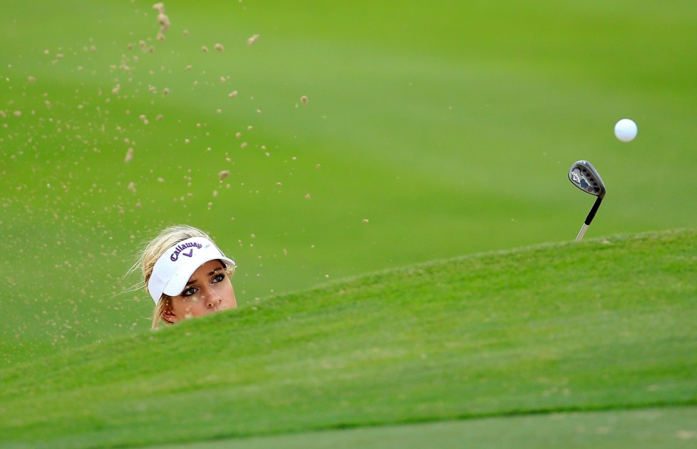 DUBAI, UNITED ARAB EMIRATES - DECEMBER 07: Paige Spiranac of the United States in action during her practice round as a preview for the 2015 Omega Dubai Ladies Masters on the Majlis Course at The Emirates Golf Club on December 7, 2015 in Dubai, United Arab Emirates. (Photo by David Cannon/Getty Images) *** BESTPIX ***