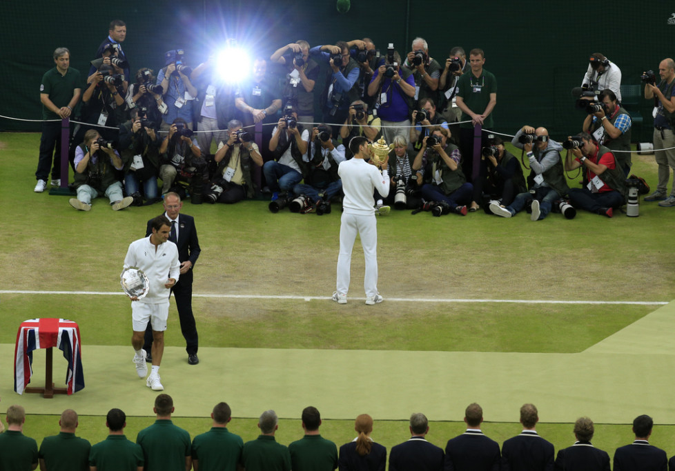 JAHRESRUECKBLICK 2015 - SPORT - Novak Djokovic of Serbia holds the trophy for the media after winning the men's singles final at the All England Lawn Tennis Championships in Wimbledon, London, Sunday July 12, 2015. (Jonathan Brady/Pool Photo via AP)