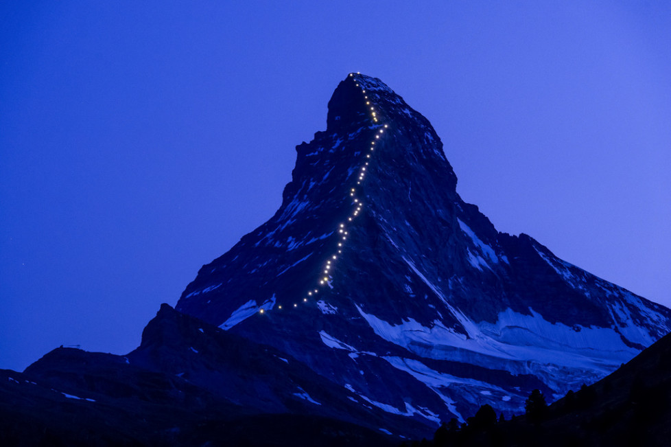 JAHRESRUECKBLICK 2015 - FEATURES - Lamps illuminate the path of the first ascent on the famous Matterhorn mountain, in Zermatt, Switzerland, Late Wednesday, July 8, 2015. On the 14th of July, Zermatt celebrates 150 years since the first ascent of the Matterhorn mountain. On July 14, 1865, the british climber Edward Whymper reached the peak of the Matterhorn (4,478 metres above sea level) together with his rope team. (KEYSTONE/Jean-Christophe Bott)