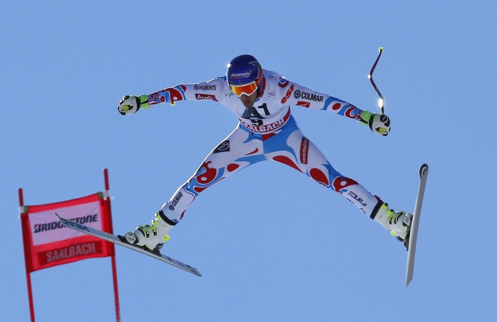 FILE - In this Feb. 20, 2015 file photo Adrien Theaux, of France, is airborne during a men's World Cup downhill training session, in Saalbach Hinterglemm, Austria. (AP Photo/Giovanni Auletta, file)