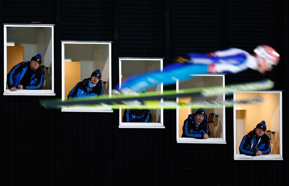 Severin Freund of Germany soars past judges windows during the normal hill HS100 mixed team ski jumping event of the Nordic World Ski Championships in Falun February 22, 2015. REUTERS/Kai Pfaffenbach (SWEDEN - Tags: SPORT SKIING) - RTR4QMGM