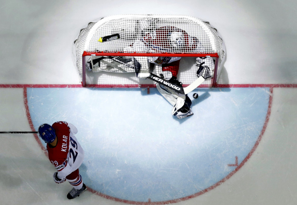 Goaltender Ondrej Pavelec of the Czech Republic (top) reacts after a goal during the Ice Hockey World Championship game against Canada at the O2 arena in Prague, Czech Republic May 4, 2015. REUTERS/David W Cerny - RTX1BJFM