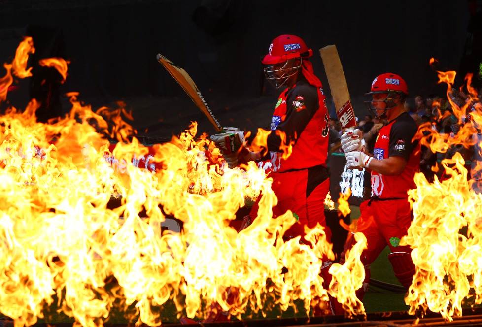MELBOURNE, AUSTRALIA - DECEMBER 30: Chris Gayle and Aaron Finch of the Renegades walk through flames to open the batting during the Big Bash League match between the Melbourne Renegades and the Perth Scorchers at Etihad Stadium on December 30, 2015 in Melbourne, Australia. (Photo by Scott Barbour/Getty Images)