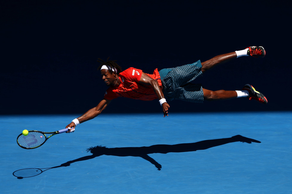 MELBOURNE, AUSTRALIA - JANUARY 25: Gael Monfils of France dives for a forehand in his fourth round match against Andrey Kuznestov of Russia during day eight of the 2016 Australian Open at Melbourne Park on January 25, 2016 in Melbourne, Australia. (Photo by Cameron Spencer/Getty Images)