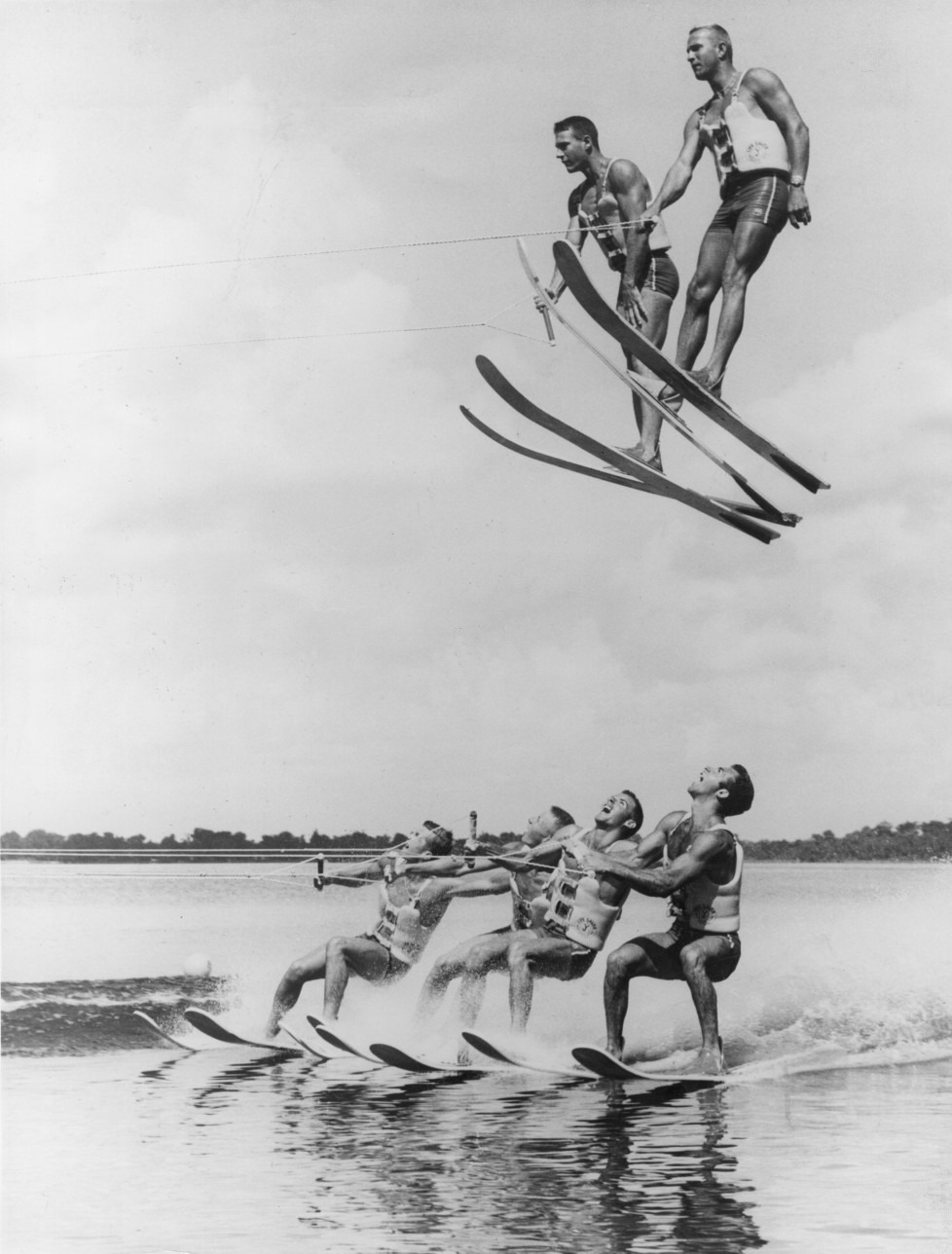 25th November 1965: A high speed water-skiing team demonstrate advanced techniques of a stunt named 'flying high and dry', at Cypress Gardens, Florida. (Photo by Alan Band/Fox Photos/Getty Images)